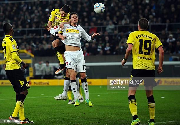 Robert Lewandowski of Dortmund heads his teams first goal past Roman Neustaedter of Moenchengladbach during the Bundesliga match between Borussia...
