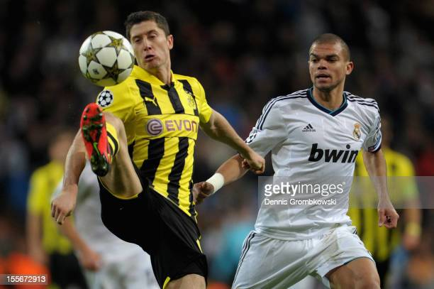 Robert Lewandowski of Dortmund is challenged by Pepe of Madrid during the UEFA Champions League Group D match between Real Madrid and Borussia...