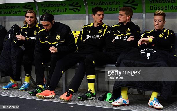 Robert Lewandowski of Dortmund is seen with team mates MArcel Schmelzer Neven Subotic Sven Bender and Marco Reus during the Bundesliga match between...