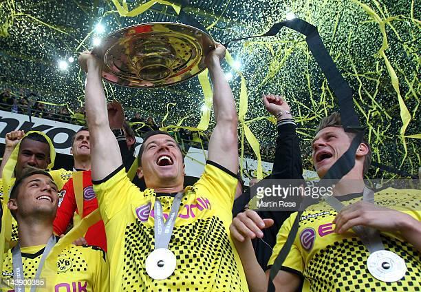 Robert Lewandowski of Dortmund lifts the trophy after winning the german championship after the Bundesliga match between Borussia Dortmund and SC...