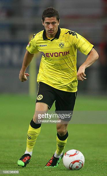 Robert Lewandowski of Dortmund runs with the ball during the pre-season friendly match between Borussia Dortmund and Manchester City at Signal Iduna...
