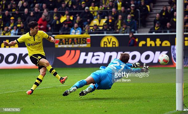 Robert Lewandowski of Dortmund scores his teams fourth goal during the Bundesliga match between Borussia Dortmund and FC Augsburg at Signal Iduna...