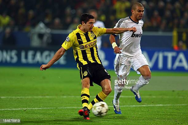 Robert Lewandowski of Dortmund scores his team's opening goal during the UEFA Champions League group D match between Borussia Dortmund and Real...