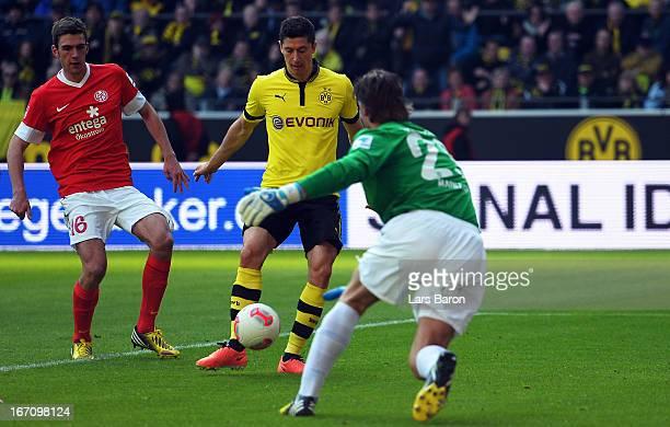 Robert Lewandowski of Dortmund scores his teams second goal during the Bundesliga match between Borussia Dortmund and 1 FSV Mainz 05 at Signal Iduna...
