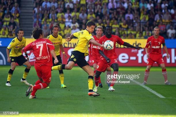 Robert Lewandowski of Dortmund scores the first goal against Hajime Hosogai and Gibril Sankoh during the Bundesliga match between Borussia Dortmund...