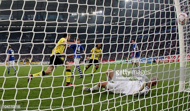 Robert Lewandowski of Dortmund scoring the third goal during the Bundesliga match between FC Schalke 04 and Borussia Dortmund at Veltins Arena on...
