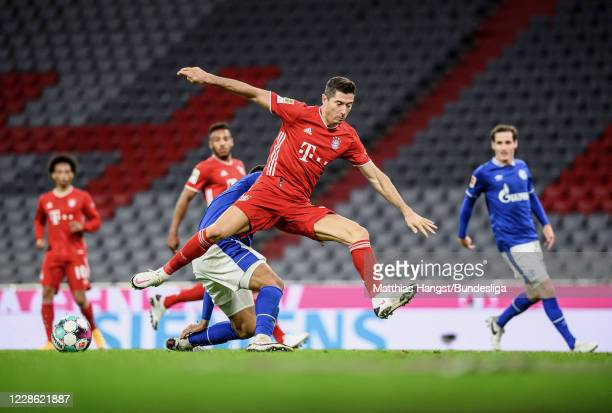 Robert Lewandowski of FC Bayern München in action against Ozan Kabak of Schalke during the Bundesliga match between FC Bayern München and FC Schalke...