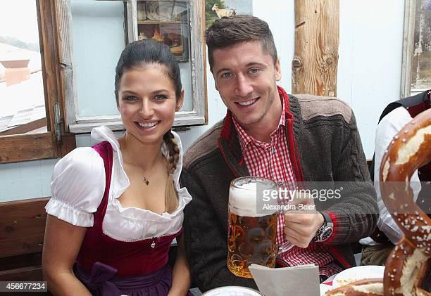 Robert Lewandowski of FC Bayern Muenchen and Anna Stachurska attend the Oktoberfest 2014 beer festival at Kaefers Wiesenschaenke at Theresienwiese on...