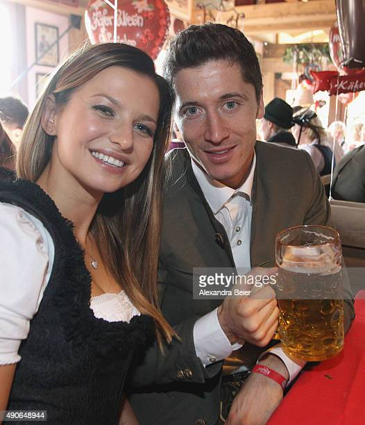 Robert Lewandowski of FC Bayern Muenchen and his partner Anna Stachurska attend the Oktoberfest beer festival 2015 at Theresienwiese on September 30...