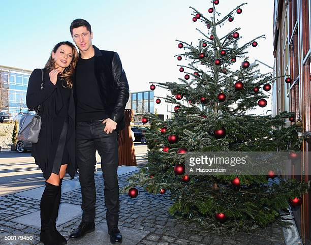 Robert Lewandowski of FC Bayern Muenchen arrives with his wife Anna Stachurska for the FC Bayern Muenchen Christmas Party at Alfons Schuhbeck`s...