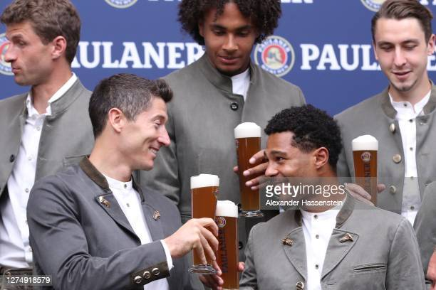 Robert Lewandowski of FC Bayern Muenchen attends with his team mate Serge Gnabry the FC Bayern Muenchen and Paulaner photo session at Nockherberg on...