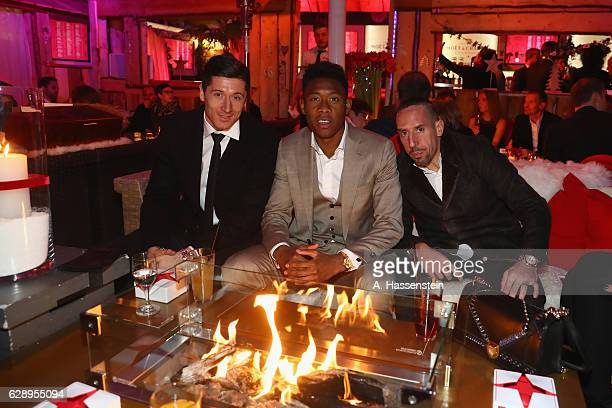 Robert Lewandowski of FC Bayern Muenchen attends with his team mates David Alaba and Franck Ribery the club's Christmas party at H'ugo's bar on...