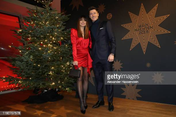 Robert Lewandowski of FC Bayern Muenchen attends with his wife Anna Lewandowska the clubs Christmas party at Allianz Arena on December 08 2019 in...