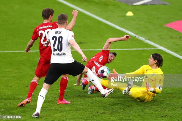 Robert Lewandowski of FC Bayern Muenchen battles for possession with Yann Sommer of Borussia Moenchengladbach during the Bundesliga match between FC...