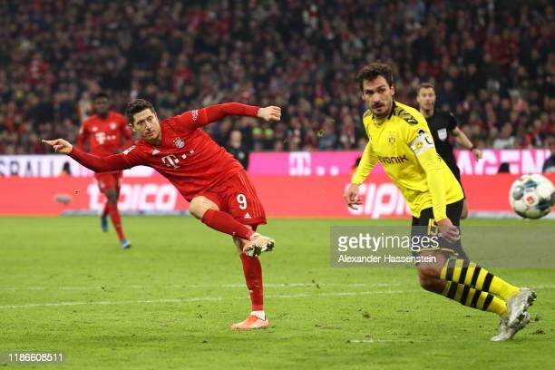 Robert Lewandowski of FC Bayern Muenchen battles for the ball with Maats Hummels of Dortmund during the Bundesliga match between FC Bayern Muenchen...