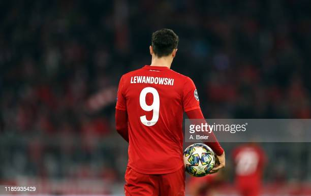 Robert Lewandowski of FC Bayern Muenchen carries the ball after he scored his first goal during the UEFA Champions League group B match between...