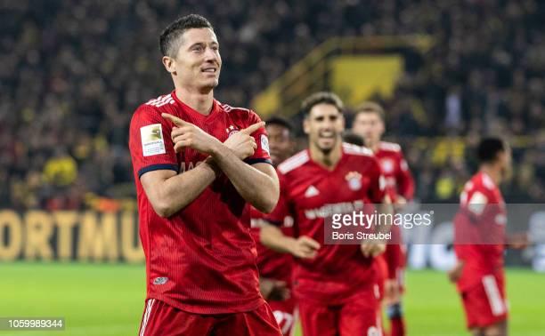 Robert Lewandowski of FC Bayern Muenchen celebrates after scoring his team's second goal during the Bundesliga match between Borussia Dortmund and FC...