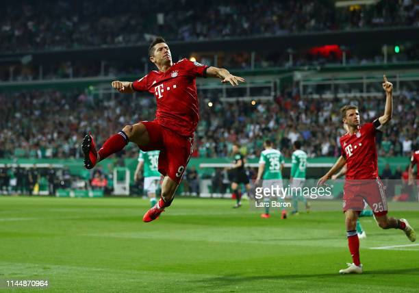 Robert Lewandowksi of FC Bayern Muenchen celebrates after scoring his team's third goal during the DFB Cup semi final match between Werder Bremen and...