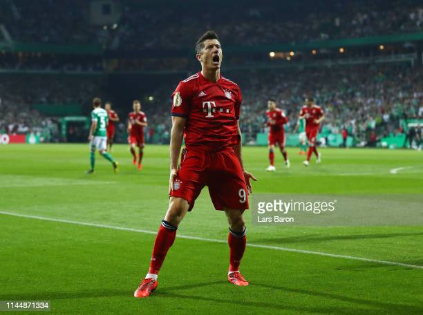 Robert Lewandowski of FC Bayern Muenchen celebrates after scoring his team's third goal during the DFB Cup semi final match between Werder Bremen and...