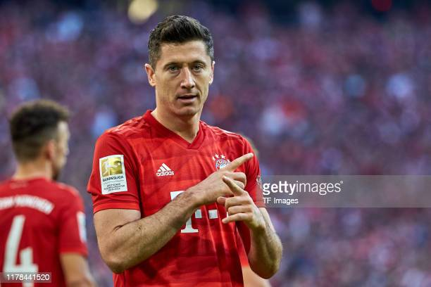 Robert Lewandowski of FC Bayern Muenchen celebrates after scoring his team's second goal during the Bundesliga match between FC Bayern Muenchen and...