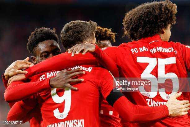 Robert Lewandowski of FC Bayern Muenchen celebrates after scoring his team's third goal with teammates during the Bundesliga match between FC Bayern...