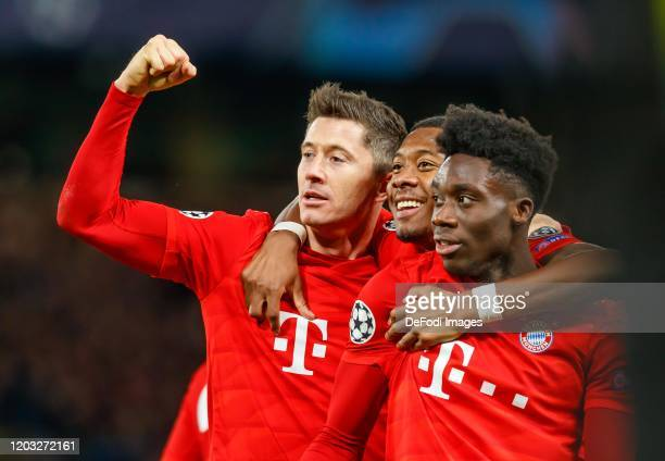 Robert Lewandowski of FC Bayern Muenchen celebrates after scoring his team's third goal with teammates during the UEFA Champions League round of 16...