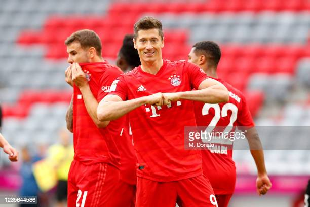Robert Lewandowski of FC Bayern Muenchen celebrates after scoring his team's third goal during the Bundesliga match between FC Bayern Muenchen and...