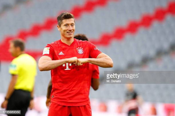 Robert Lewandowski of FC Bayern Muenchen celebrates after scoring his team's fourth goal during the Bundesliga match between FC Bayern Muenchen and...