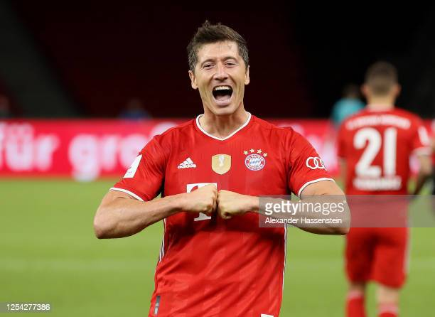 Robert Lewandowski of FC Bayern Muenchen celebrates after scoring his team's fourth goal during the DFB Cup final match between Bayer 04 Leverkusen...