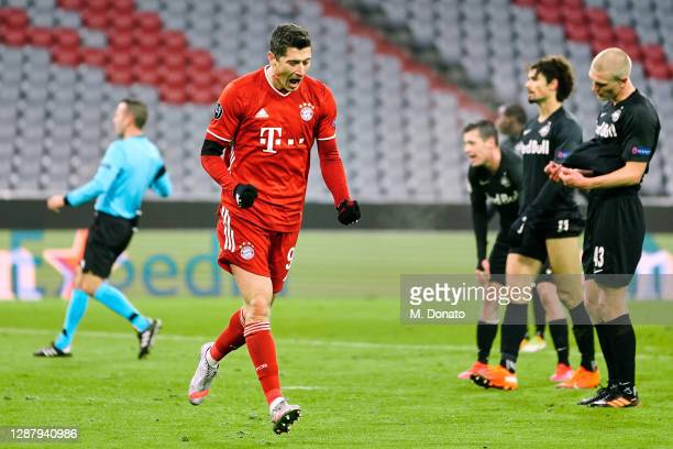 Robert Lewandowski of FC Bayern Muenchen celebrates after scoring his team's first goal during the UEFA Champions League Group A stage match between...