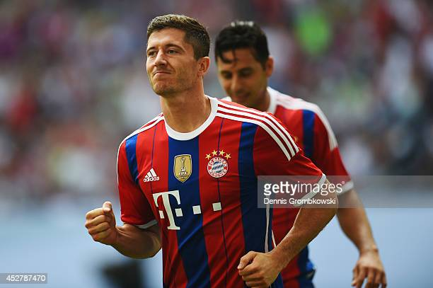 Robert Lewandowski of FC Bayern Muenchen celebrates after scoring his team's first goal during the Telekom Cup 2014 final match between FC Bayern...