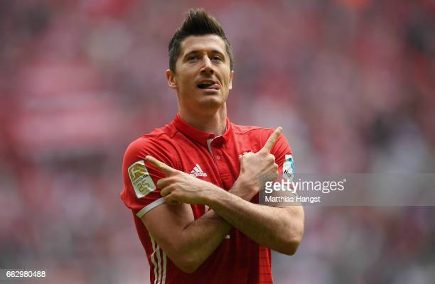 Robert Lewandowksi of FC Bayern Muenchen celebrates after scoring his team's first goal during the Bundesliga match between Bayern Muenchen and FC...