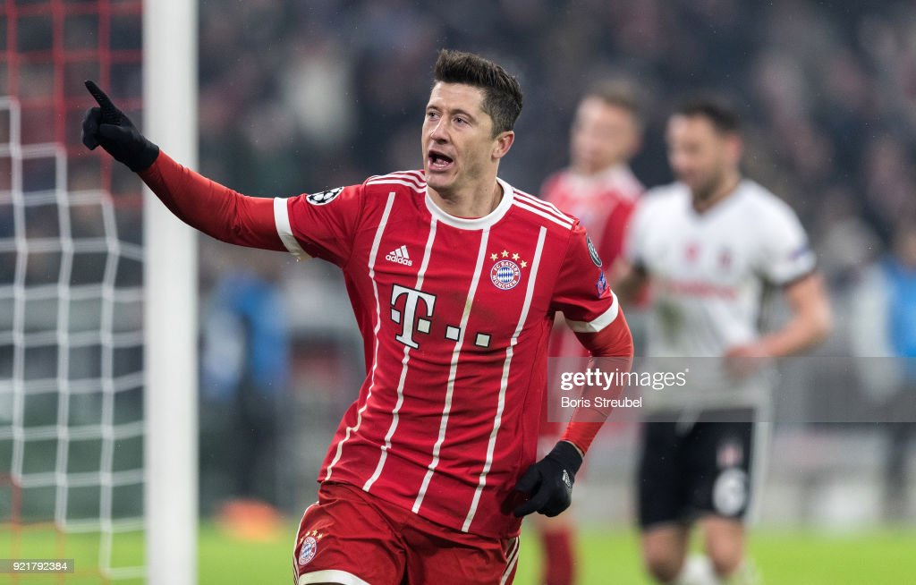 Robert Lewandowski of FC Bayern Muenchen celebrates after scoring his team's fourth goal during the UEFA Champions League Round of 16 First Leg match between Bayern Muenchen and Besiktas at Allianz Arena on February 20, 2018 in Munich, Germany.