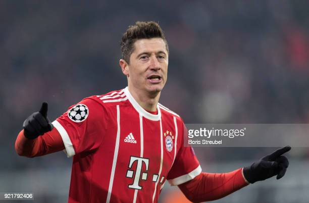 Robert Lewandowski of FC Bayern Muenchen celebrates after scoring his team's fourth goal during the UEFA Champions League Round of 16 First Leg match...