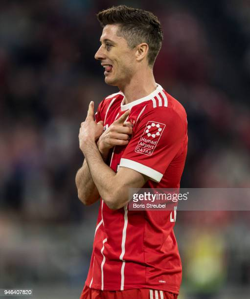 Robert Lewandowski of FC Bayern Muenchen celebrates after scoring his team's fifth goal during the Bundesliga match between FC Bayern Muenchen and...