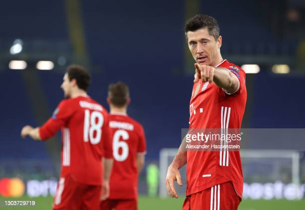 Robert Lewandowski of FC Bayern Muenchen celebrates after scoring their sides first goal during the UEFA Champions League Round of 16 match between...