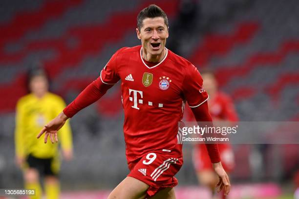 Robert Lewandowski of FC Bayern Muenchen celebrates after scoring their side's fourth goal, completing his hat-trick during the Bundesliga match...