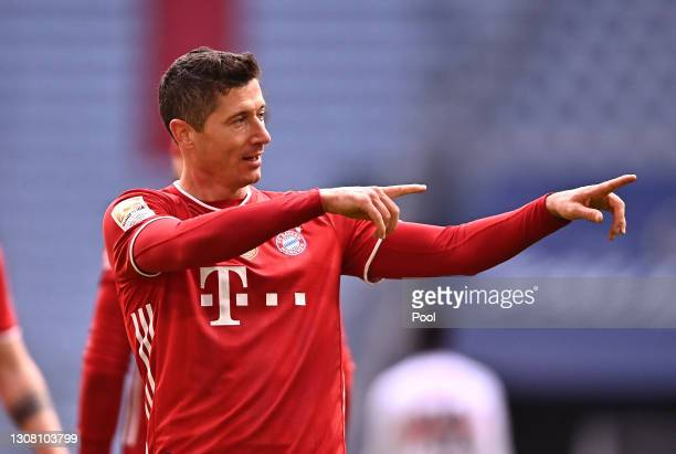 Robert Lewandowski of FC Bayern Muenchen celebrates after scoring their team's third goal during the Bundesliga match between FC Bayern Muenchen and...