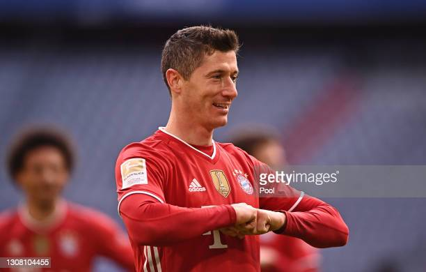 Robert Lewandowski of FC Bayern Muenchen celebrates after scoring their side's third goal during the Bundesliga match between FC Bayern Muenchen and...