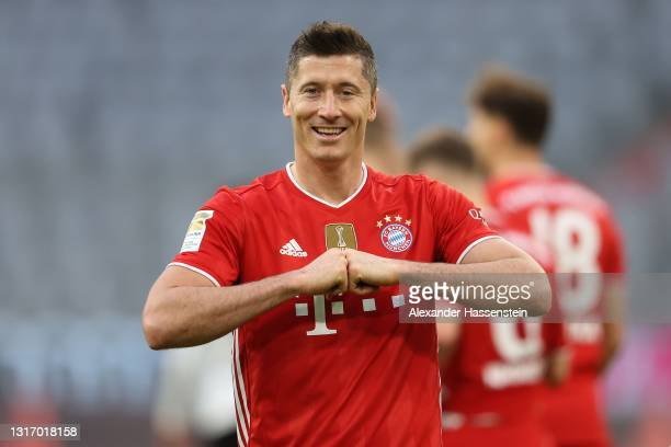 Robert Lewandowski of FC Bayern Muenchen celebrates after scoring their side's fifth goal during the Bundesliga match between FC Bayern Muenchen and...
