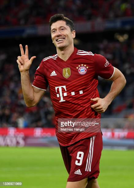 Robert Lewandowski of FC Bayern Muenchen celebrates after scoring their sides fifth goal for their hat trick during the Bundesliga match between FC...