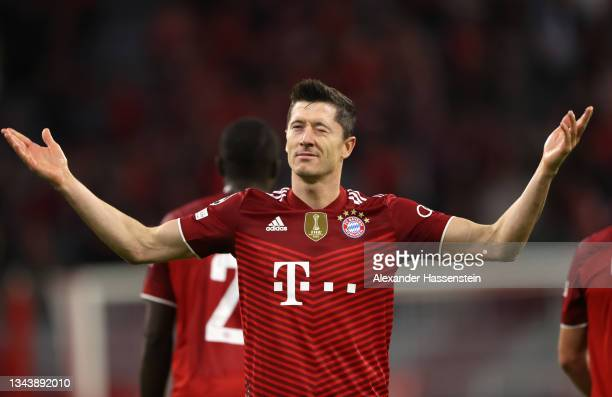 Robert Lewandowski of FC Bayern Muenchen celebrates after scoring their side's second goal during the UEFA Champions League group E match between FC...
