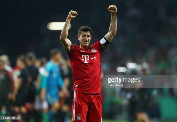 Robert Lewandowski of FC Bayern Muenchen celebrates after the DFB Cup semi final match between Werder Bremen and FC Bayern Muenchen at Weserstadion...