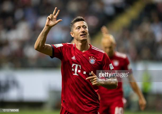 Robert Lewandowski of FC Bayern Muenchen celebrates by showing three fingers after scoring his third goal during the DFL Supercup 2018 match between...