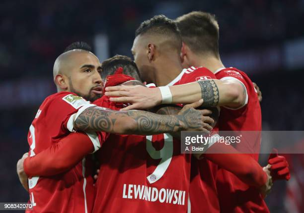 Robert Lewandowski of FC Bayern Muenchen celebrates his first goal with teammates Arturo Vidal Jerome Boateng and Niklas Suele during the Bundesliga...