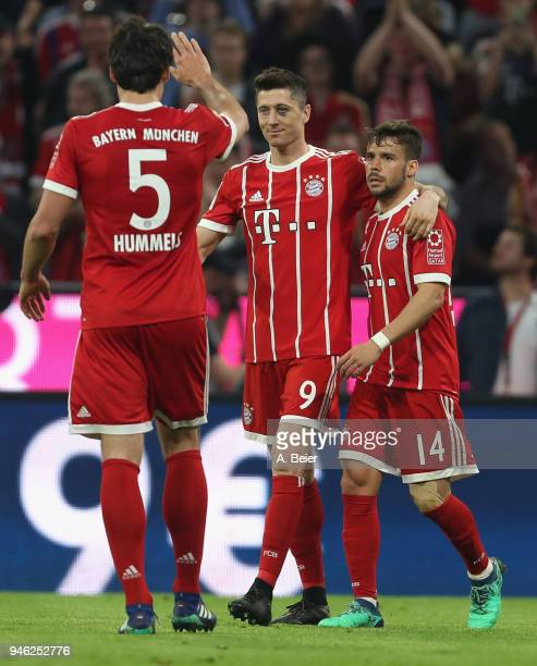 Robert Lewandowski of FC Bayern Muenchen celebrates his goal with teammates Juan Bernat and Mats Hummels during the Bundesliga match between FC...