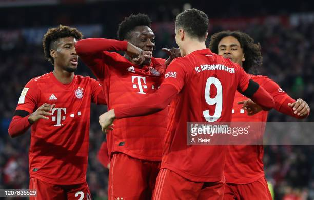 Robert Lewandowski of FC Bayern Muenchen celebrates his second goal with teammates Kingsley Coman Alphonso Davies and Joshua Zirkzee during the...