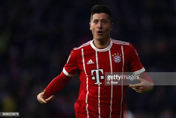 Robert Lewandowski of FC Bayern Muenchen celebrates his second goal during the Bundesliga match between FC Bayern Muenchen and Werder Bremen at...