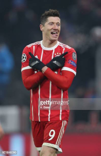 Robert Lewandowski of FC Bayern Muenchen celebrates his second goal during the UEFA Champions League Round of 16 first leg match between FC Bayern...