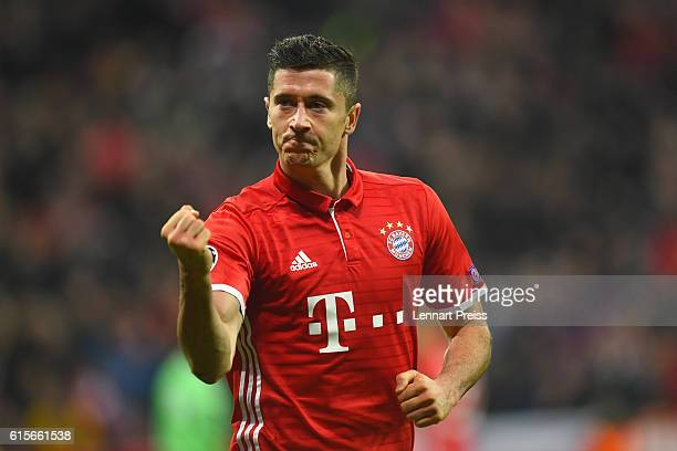 Robert Lewandowski of FC Bayern Muenchen celebrates scoring his team's third goal during the UEFA Champions League match between FC Bayern Muenchen...